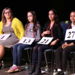 A row of four spellers await the judges' decision