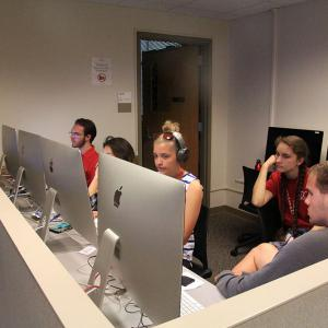 Students editing their footage on Mac computers