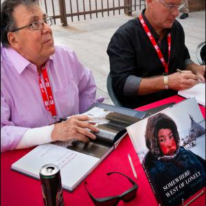 Raymer looks up while signing copies of his new book.
