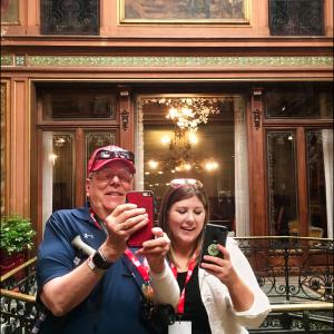 Raymer and his daughter, Katelynn, take a photo in front of a mirror