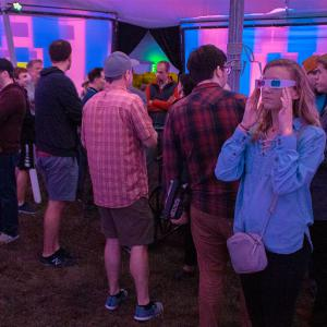 A Big Tent visitor watches the content through 3-D glasses.