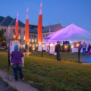 The glowing white Big Tent attracts people as they walk past the corner of Fourth and Washington streets