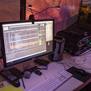 A desktop computer and keyboard on a table outside of the Big Tent.