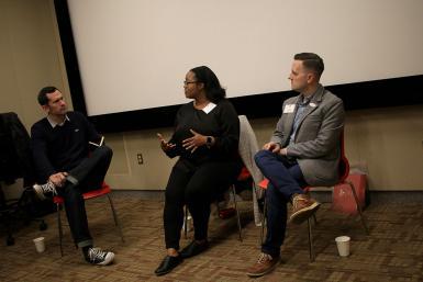 Media School alumni Robin Robinson, BA'07, and Greg Sorvig, BA'06, speak about programming film festivals as lecturer Craig Erpelding moderates.