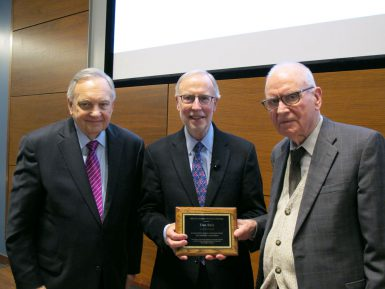 Dan Balz, senior correspondent with The Washington Post, accepts the Lee H. Hamilton Public Service Fellowship plaque from Lee Hamilton, distinguished scholar in the School of Public and Environmental Affairs and former U.S. representative for Indiana. At left is Edward Carmines, Distinguished Professor, Warner O. Chapman Professor of Political Science and Rudy Professor at IU. Balz visited IU to receive the fellowship and to present a lecture as part of The Media School's Speaker Series. (Anne Kibbler | The Media School)