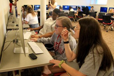 Students edit footage together in the documentary film class