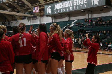 Master's student Morgan Gard films a huddle during a match at Michigan State University.