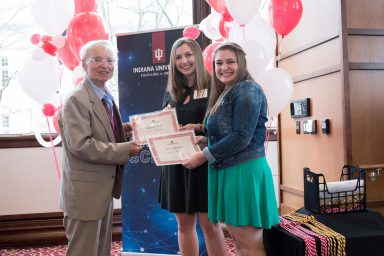 Professor Emeritus Cleve Wilhoit presented Kara Williams and Emerson Wolff with the Frances Wilhoit Research Paper Awards.