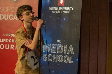 Eighth grader Daniel Larsen takes the microphone at the IU Bee.