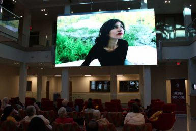 An audience in the Franklin Hall commons watches one of the films produced by Punjabi students. (Courtesy photo)