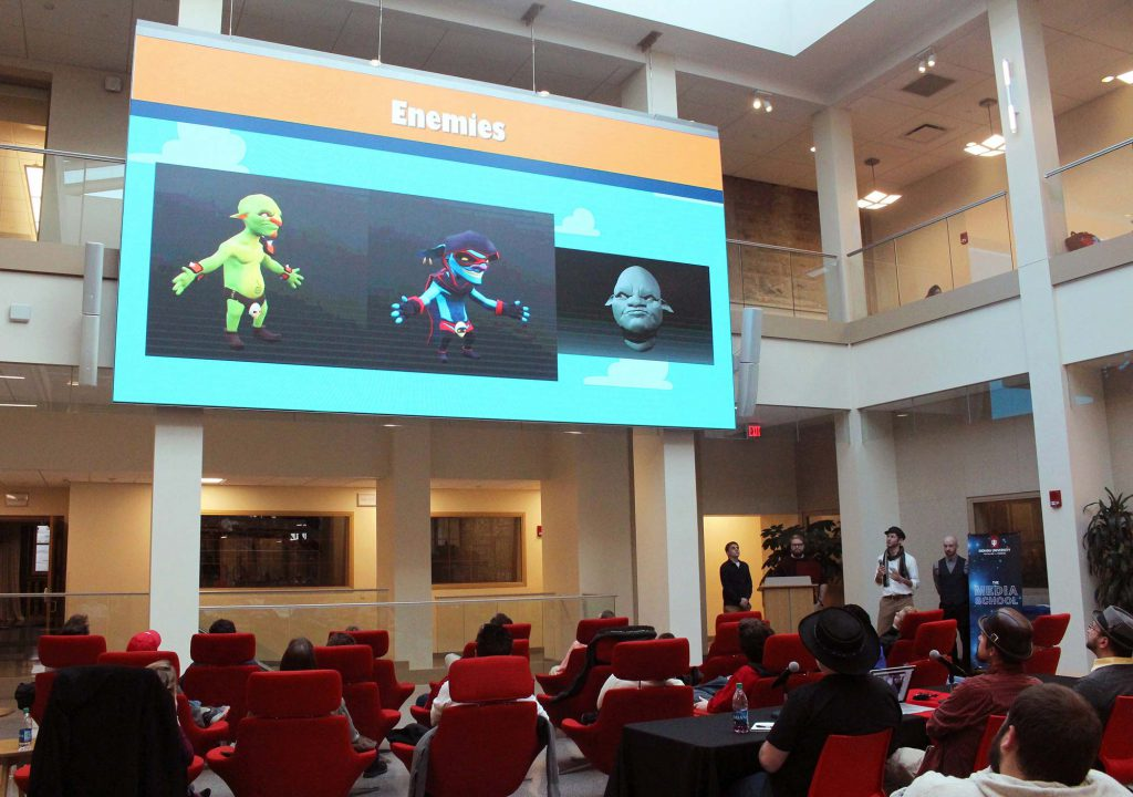 The creators of Boarding Action present their mobile game at the game design program's Shark Tank-style pitch night.