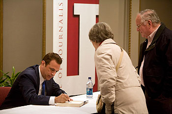 After his talk, Beschloss signed books for audience members. His latest book is Presidential Courage: Brave Leaders and How They Changed America 1789-1989. (Photo by Jeremy Hogan)