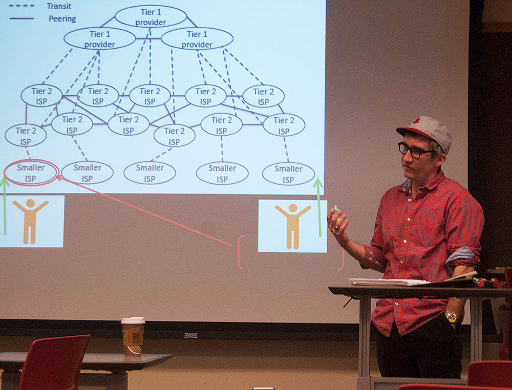 Assistant professor Julien Mailland showed a diagram to explain different tiers of Internet service providers. (Craig Lyons, master's student | The Media School)