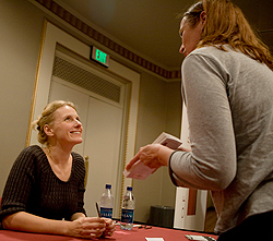 Gilbert signed books for a long line of fans after the lecture. (Photo by Jeremy Hogan)