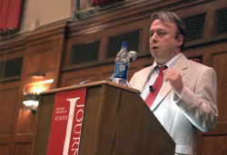 Journalist Christopher Hitchens speaks at Alumni Hall in the IMU to a crowd of over 300. His talk was the first in the new speaker series. (Photo by Anna Norris)