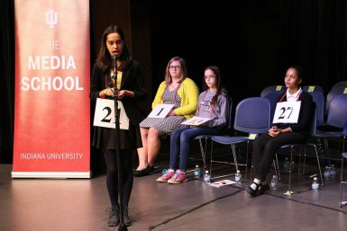 For several rounds, the contestants included the same four: Ganguly, spelling, and, seated from left, last year's winner Chloee Robinson, Katrina Brown and Lily Henning. (Jill Moore | The Media School)