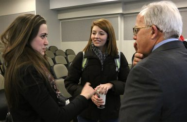Junior Hannah Alani, left, and sophomore Carley Lanich chatted with Kern after the talk. (Jill Moore | The Media School)