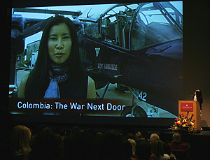During her talk, Ling described her reporting experiences by showing clips to the audience. (Photo by Jeremy Hogan)