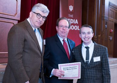 Austin Faulds received the International Press Freedom Scholarship and the Beth Wood Award. Dean James Shanahan, left, and associate professor Tony Fargo presented the awards. (Ann Schertz Photography)