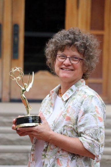 Senior Lecturer Susanne Schwibs holding her regional Emmy