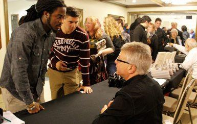 Uslan signing books