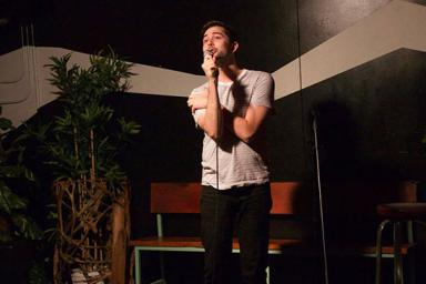 Griffin Leeds, BA'15, performs standup comedy at Mad Tropical in Brooklyn.