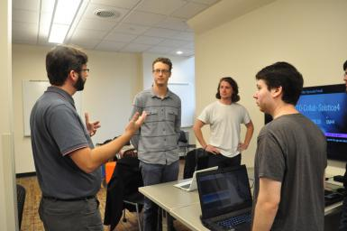 Will Emigh, left, and seniors from the game design program