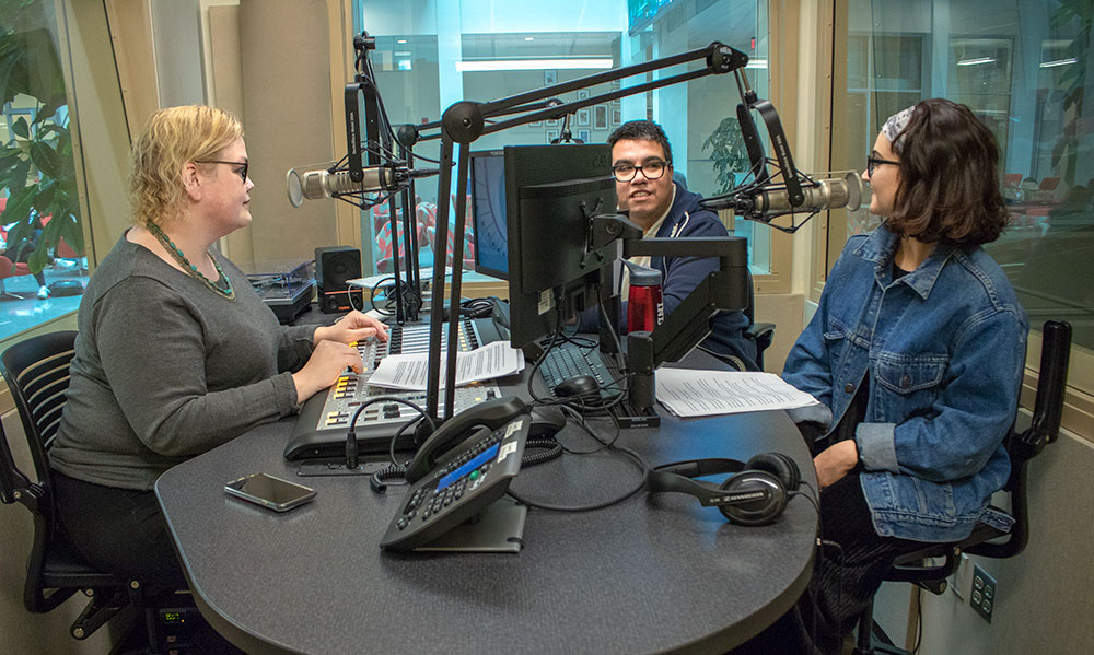 Reporters Beth Edwards and Enrique Saenz, and coordinator Alexa Chryssovergis rehearse for the Indiana Environmental Reporter's podcast On Air with IER.