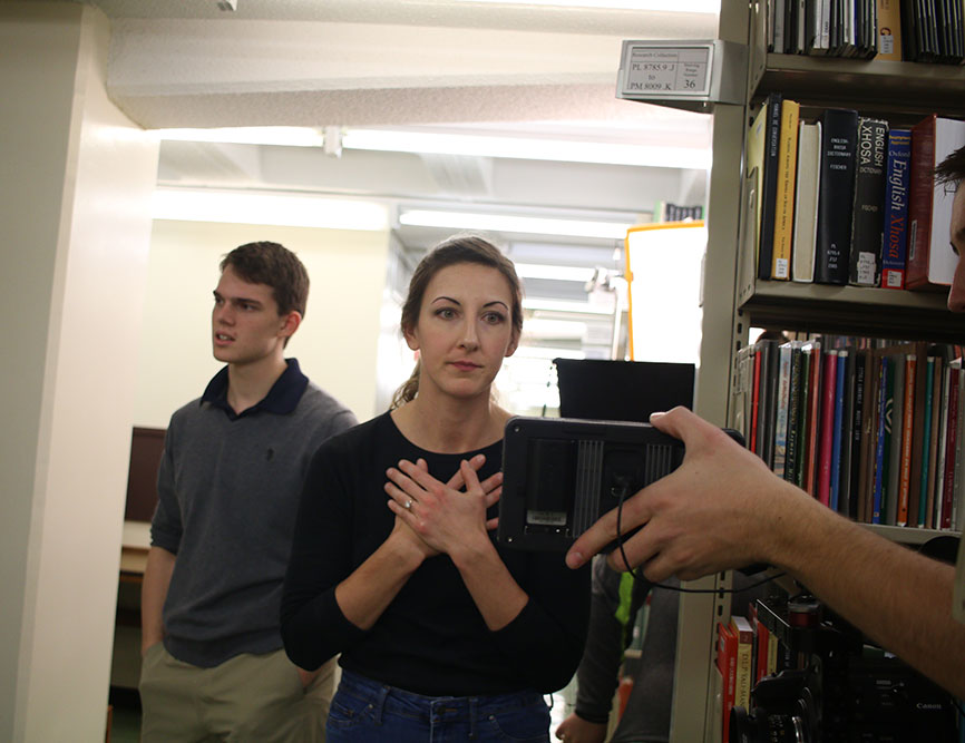 Director Kasey Poracky, an M.S. student in The Media School, reviews a scene shot in the Wells library. Poracky worked with Jacobs School of Music ballet students and Media School undergraduates to create Shift, a short film featuring 14 dancers.