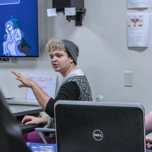 Sophomore Justin Hatfield presents his game to the other Global Game Jam participants.
