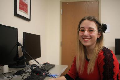 Junior Beth Lula sitting at a computer