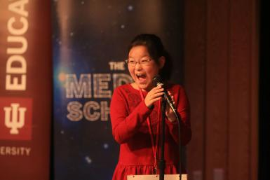 University Elementary School fourth grader Yena Park gasps into the microphone after winning the IU Bee.