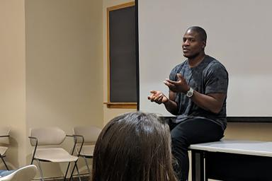 Former NFL defensive end and IU football star Adewale Ogunleye speaks to assistant professor Lauren Smith's Sports, Media and Society class.