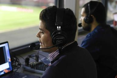 Juan Diego Alvarado broadcasting a soccer game from the press box