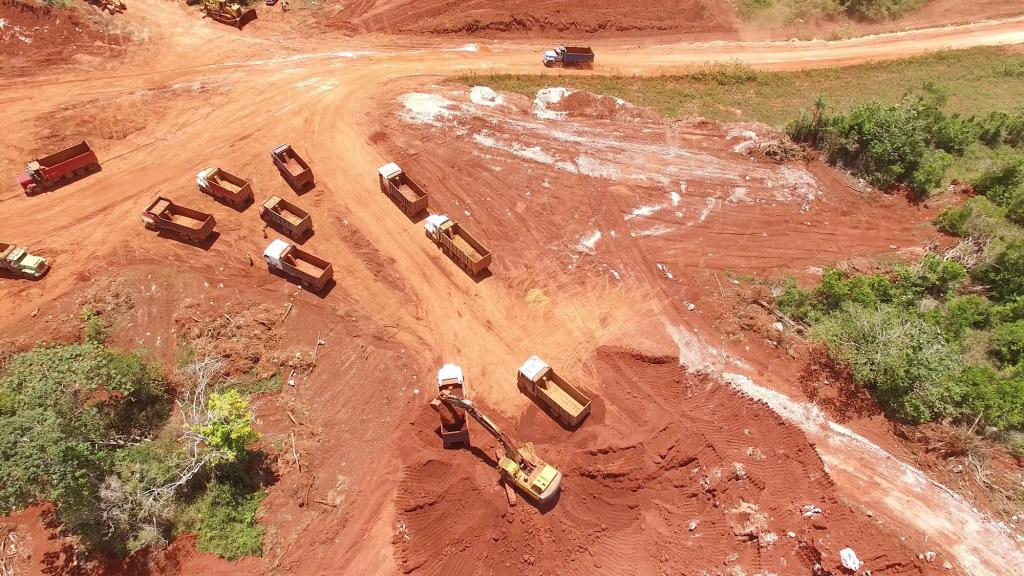 Aerial footage of trucks mining bauxite in Jamaica