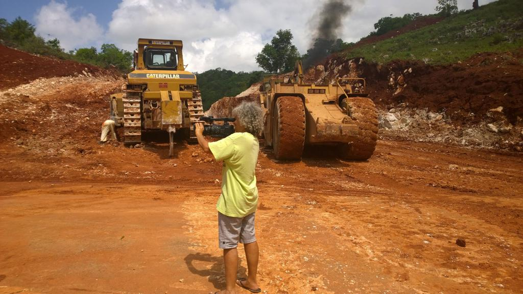 Esther Figueroa shooting video of bauxite mining trucks in Jamaica