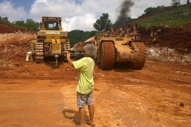 Esther Figueroa shooting video of bauxite mining trucks in Jamaica