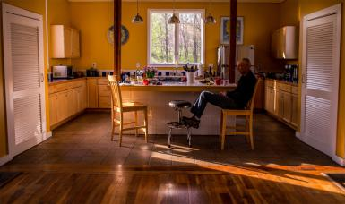 Craig Guyon sits in the kitchen of his home in Lanesville, Indiana.