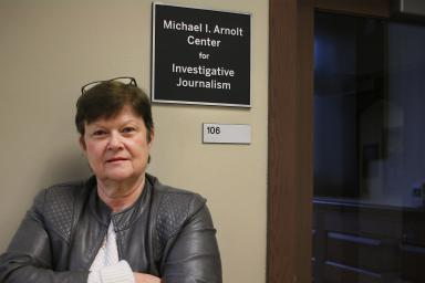 Kathleen Johnston standing outside the Michael I. Arnolt Center for Investigative Journalism