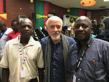 Professor Michael Martin posing with the two sons of the late Senegalese pioneer filmmaker Paulin Vieyra.