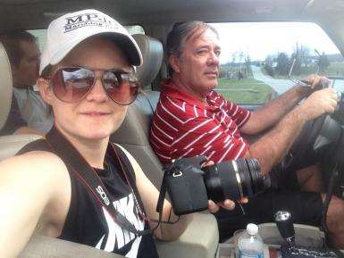 M.S. student Layn Pieratt rides in a car with her father, Marty Pieratt. Layn is holding a camera.