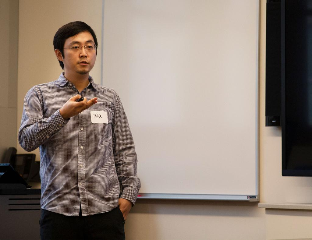"Media School doctoral candidate Xia Zheng presents his paper, ""Negative Bias, Political Attitudes, and Dynamic Coordination of Morality,"" in the session, ""Media Polarization, Partisanship and Politics."""