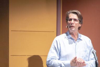 James Balog speaking at a podium