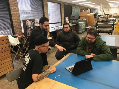(Left to right) Texas Tech associate art professor Stacy Elko, IU Media School assistant professor John Velez and two graduate students review an early version of the app.
