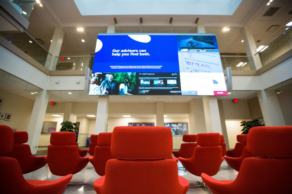 "The digital screen in the Franklin Hall commons. It says: ""Our advisors can help you find both."""