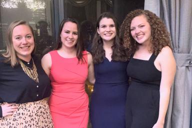 Laurel Demkovich, Sarah Verschoor, Caroline Anders and Lydia Gerike pose outside a doorway at at a Hearst event.