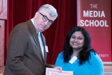 Dean Jim Shanahan presents Pallavi Rao with the Frances G. Wilhoit Research Paper Aawrd.