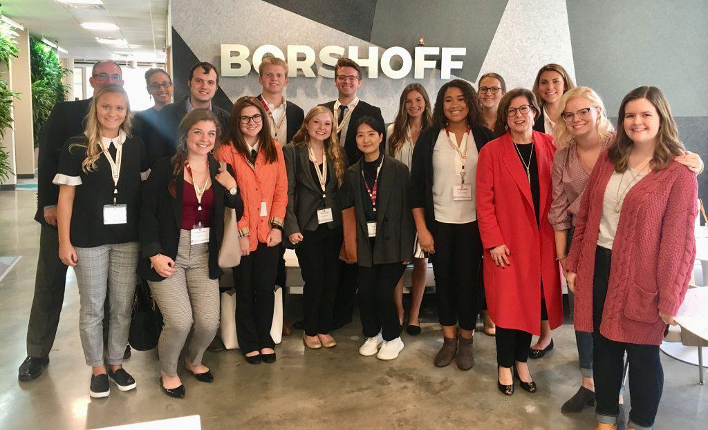 A group of students poses at Borshoff public relations agency