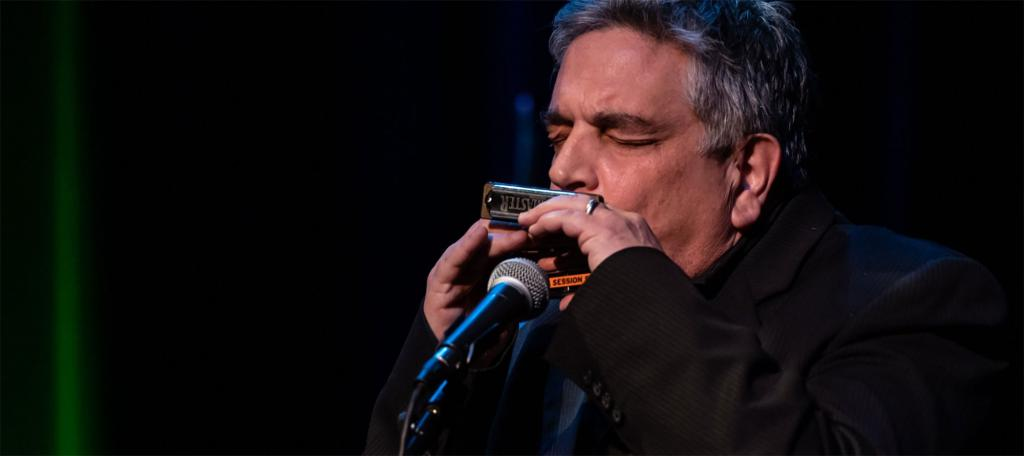 "Daniel ""Catfish"" Russ playing the harmonica"