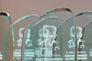Five Distinguished Alumni Award trophies